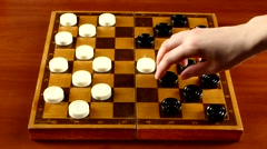 Two persons start playing on checker board, time lapse Stock Footage