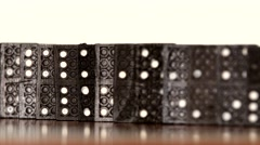 Domino, isolated on white, dynamic change of focus, dolly shot Stock Footage