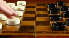 Two persons playing on checker board, slow motion, close up Stock Footage