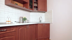 Interior of brown and white domestic kitchen, nobody Stock Footage