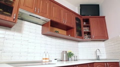 Brown and white domestic kitchen, nobody Stock Footage