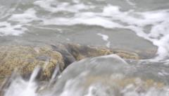 A wave washes stone closeup. - stock footage