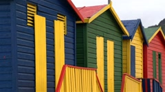 Long lense shot of colourful beach houses/huts - stock footage