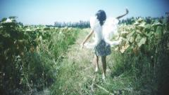 Girl using angel wings - stock footage