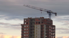 Construction Crane on the Background of Fast Moving Clouds Logo Stock Footage