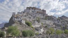 Thicksey gompa with monks climbing footpatch down,Thiksey,Ladakh,India Stock Footage