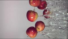 Apples are flying in jets of water Stock Footage