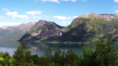 Fjord with waterfall and trees, norway, time lapse Stock Footage