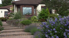 Front garden and path of bungalow, England Stock Footage