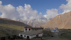 TIMELAPSE View of house with snow capped mountains,Kibber,Spiti,India Stock Footage