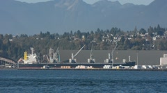 WS freighter at dock with mountains in BG. Port of  Vancouver, BC Canada Stock Footage