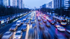 Dreamy busy second ring road traffic and buildings in Beijing. Slow motion Stock Footage
