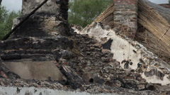 Zoom out, Burned out roof of Irish cottage, Ireland Stock Footage