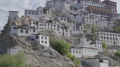 Thicksey gompa detail with monks climbing footpatch down,Thiksey,Ladakh,India Stock Footage