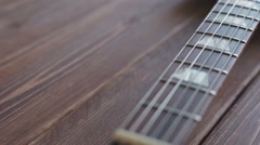 Electric guitar on the wooden desk Stock Footage