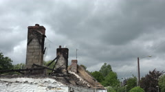 Burned out roof and chimney of Irish cottage, Ireland - stock footage