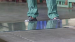 Two Workers Stand on Tempered Glass Swing On It Throw Glass On The Floor Glass - stock footage