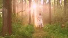 Beautiful Fairy Tale Princess Running In Woods Sun Shining Through Morning Mist Stock Footage