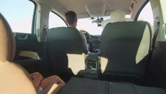 Young family with little girl in child back seat traveling by car Stock Footage