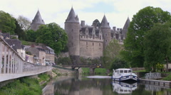 River Oust forming part of the Nantes Brest Canal and the Castle at Josselin Stock Footage