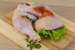 Raw chicken leg - stock photo
