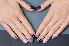Female hands with a stylish neutral manicure - stock photo