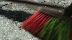 Worker Sweeps A Broom Fragments Of Tempered Glass On Floor Manufacturing - stock footage