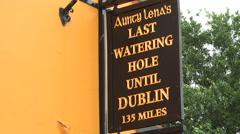 Aunty Lenas typical Irish pub sign, Adare, Ireland Stock Footage