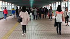 Time Lapse / Zoom - Crowded Pedestrian Walkway in Kowloon Hong Kong Stock Footage