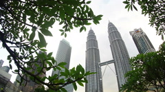 Stock Video Footage of Petronas Twin Towers is surrounded by nature captured during daytime