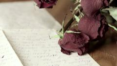 Vintage background with faded rose bouquet and old handwritten letter Stock Footage