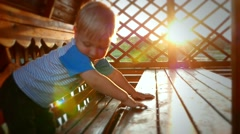 Baby kid child boy in the rays of the sun caressing 002 Stock Footage