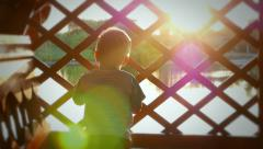 Baby kid child boy in the rays of the sun caressing Stock Footage