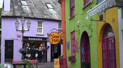Tourists visit brightly coloured shops in Kinsale, Ireland Stock Footage