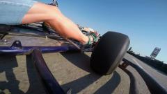 Stock Video Footage of Karting driver rushes recreational go-kart crosses finish line on kart track