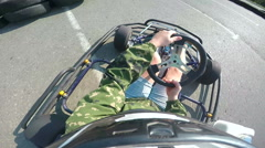Karting female driver rushes on kart circuit outdoor camera mounted on helmet - stock footage