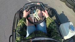 Karting driver rushes recreational go-kart on kart track camera on helmet - stock footage