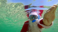 Slow motion Santa Claus snorkeling underwater on tropical beach getaway Stock Footage