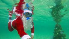 Scuba with Santa Claus beside Christmas tree under water Stock Footage