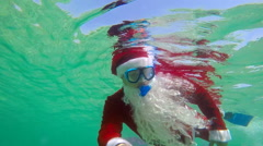 Santa Claus coming on Christmas day under water Stock Footage