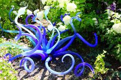 Purple blown glass tubes in Garden Stock Photos