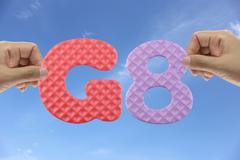 Hand arrange alphabet G8 of acronym Group of Eight. Stock Photos