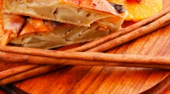 Apple pie with cinnamon sticks Stock Footage