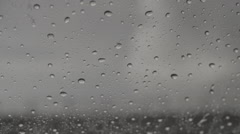 Rain on window wiper removes water Stock Footage