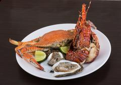 Spiny lobster, crab and oyster - stock photo