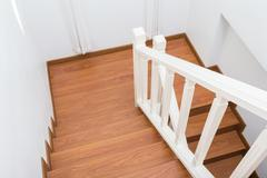 Wooden staircase made from laminate wood in white modern house Stock Photos