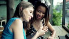 Happy, excited woman showing her engagement ring to friend in cafe Stock Footage