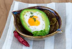Egg backed in avocado - stock photo