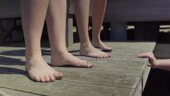 Closeup Of Sandy Bare Feet On A Dock (Slow Motion) Stock Footage
