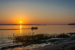 Sunrise on the river Volga. - stock photo
